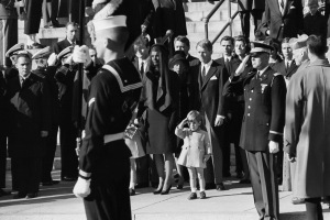 25 Nov 1963, Washington, DC, USA --- John F. Kennedy Jr., who turns three today, salutes as the casket of his father, the late President John F. Kennedy, is carried from St. Matthew's Cathedral in Washington, DC. --- Image by © Bettmann/CORBIS